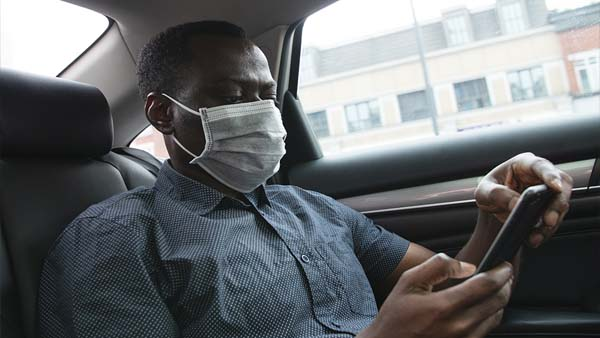 Person wearing mask looking at phone